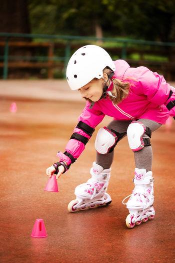 Cute girl skating outdoors