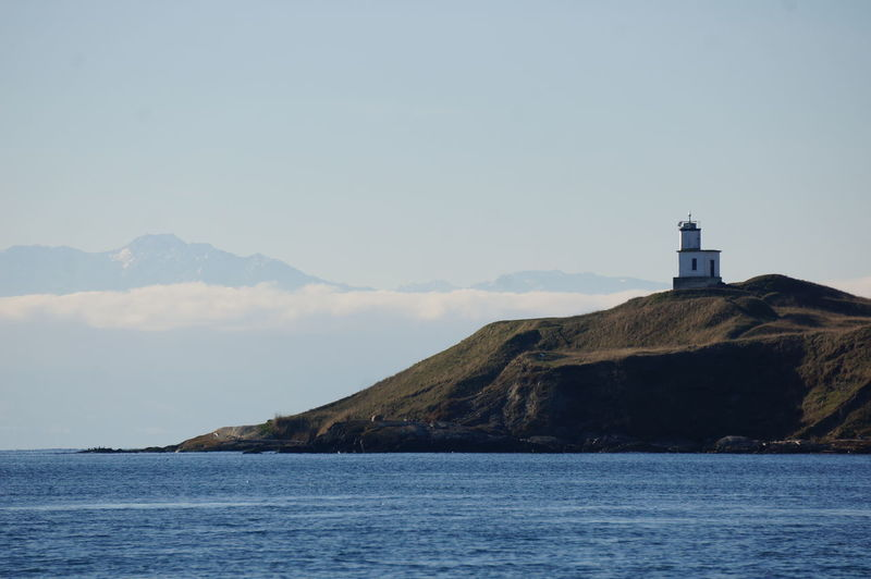 Light house signal Beacon Of Hope Inland Sea Barren Landscape Barren Beauty San Juan Islands Fishing Port Navigation Mark Salish Sea Winter Sky In Washington Olympic Peninsula Point Of View Distant Mountains Open Spaces Scenics - Nature Scenics Clean Air Peaceful Remote Place Island And Sea Island Seascape No People Sunrise Architecture Lighthouse Nature Land Outdoors Bay Beach
