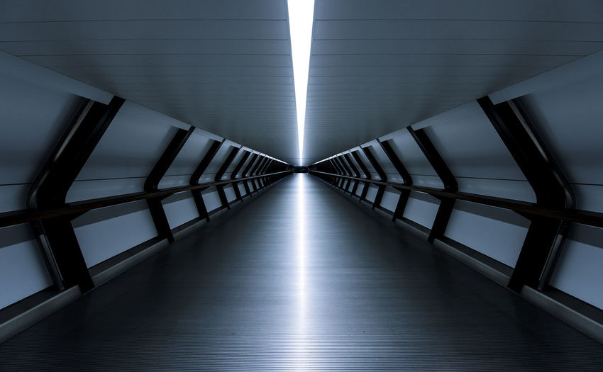 Illuminated Walkway In Tunnel