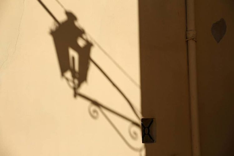 Light Lightbulb Structure Shadow Outdoors Built Structure No People Day Architecture The Graphic City