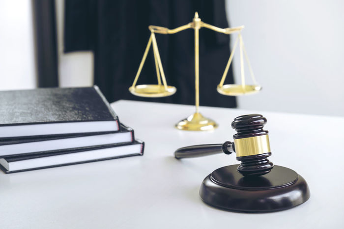 Advice Balance Book Close-up Courtroom Day Dispute Focus On Foreground Gavel Hammer Indoors  Inheritance Instruction Judiciary Jurisprudence Justice Law Legal Legislation No People Scales Still Life Table Verdict White Background