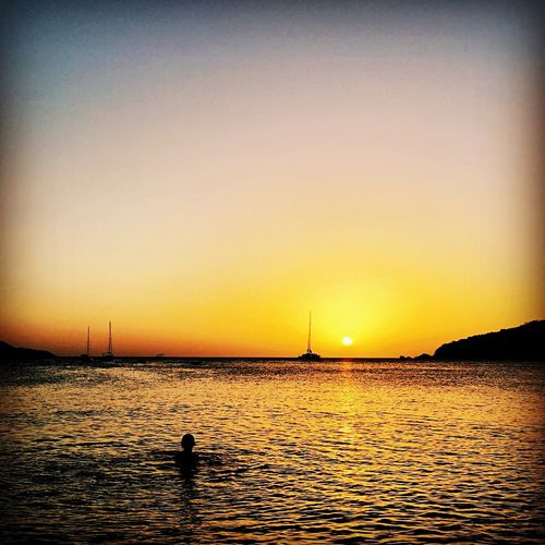 Sunset Water Sea Clear Sky Scenics Tranquility Waterfront Nature Tranquil Scene Outdoors Beauty In Nature One Person Real People Sun Sky Day
