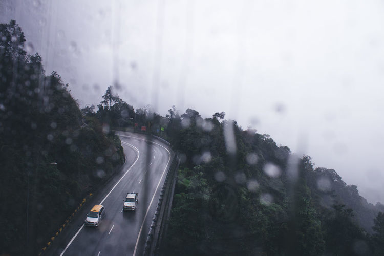 High angle view of cars on road against sky