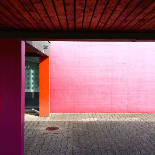 Pink School Building By Footpath
