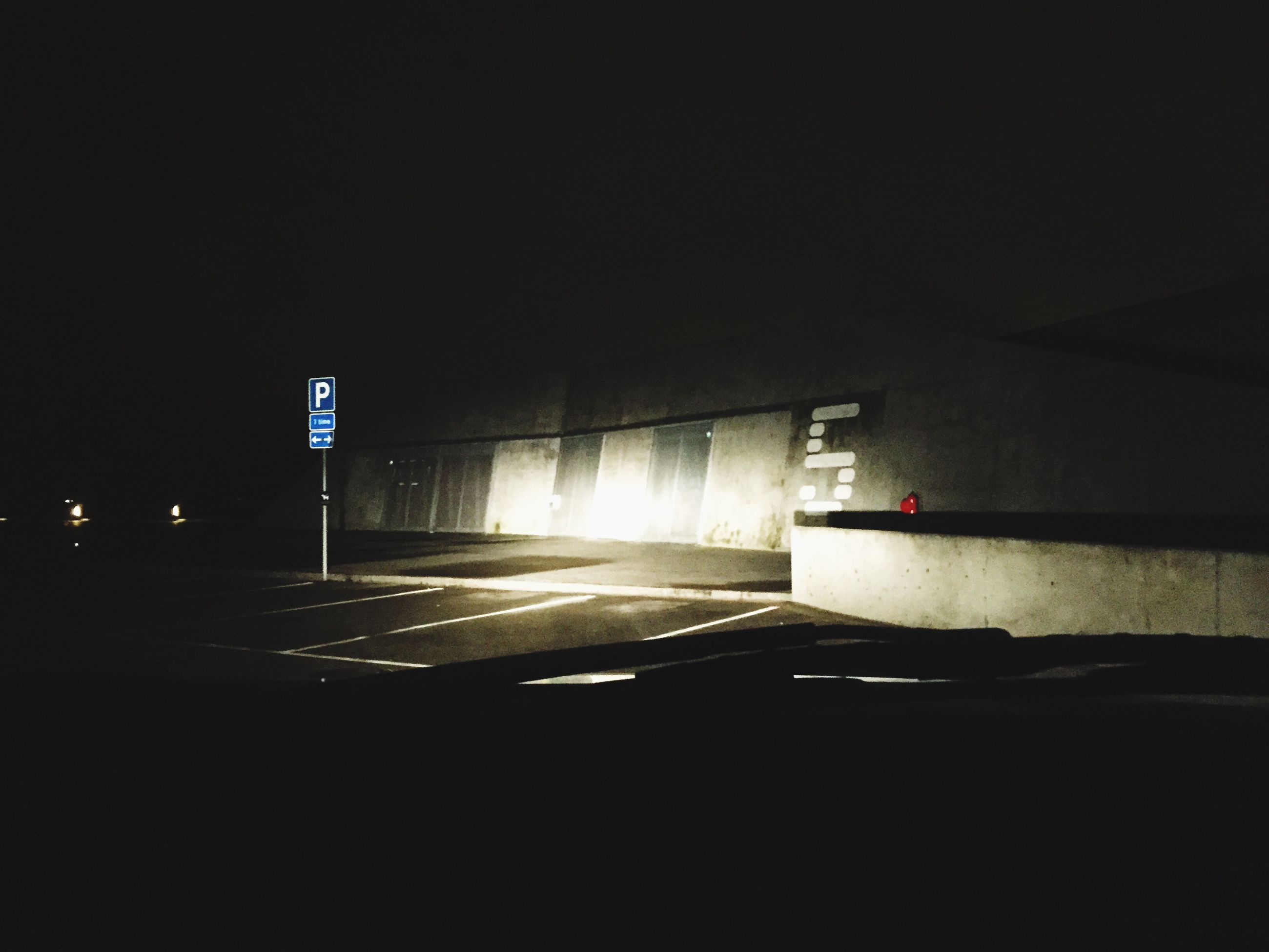 transportation, illuminated, copy space, road, red, night, guidance, street, clear sky, empty, no people, road marking, mode of transport, lighting equipment, absence, car, land vehicle, outdoors, dark, built structure