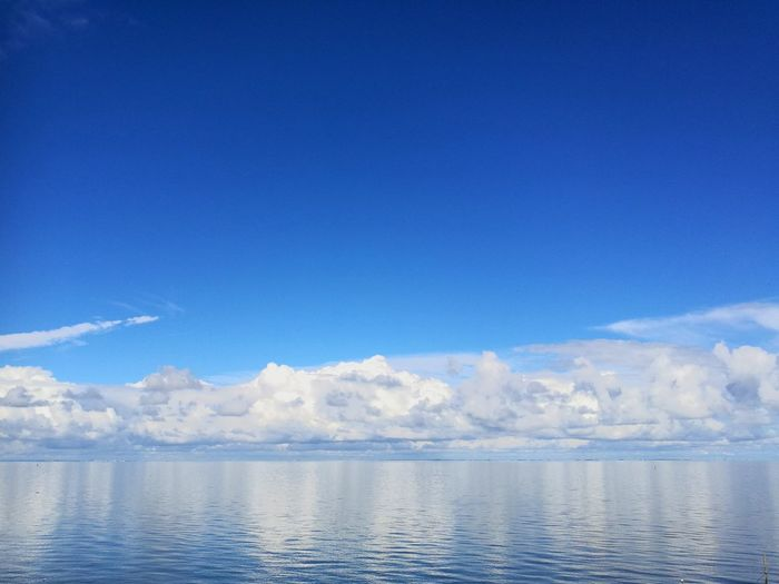 Water Blue Sea Nature No People Cloud - Sky Beauty In Nature Tranquility Outdoors Day Sky Scenics Landscape Sky And Clouds Tranquility Sky Blue Cloud Clouds And Sky
