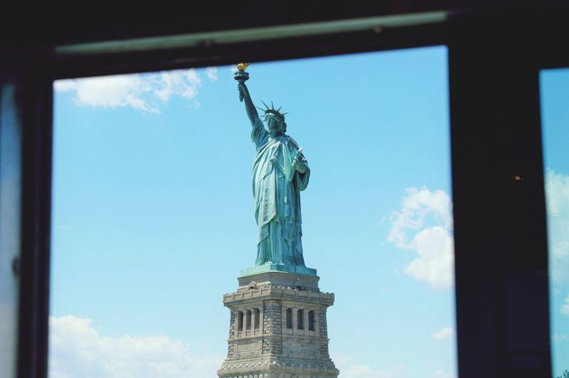 View Of Statue Of Liberty Through Window