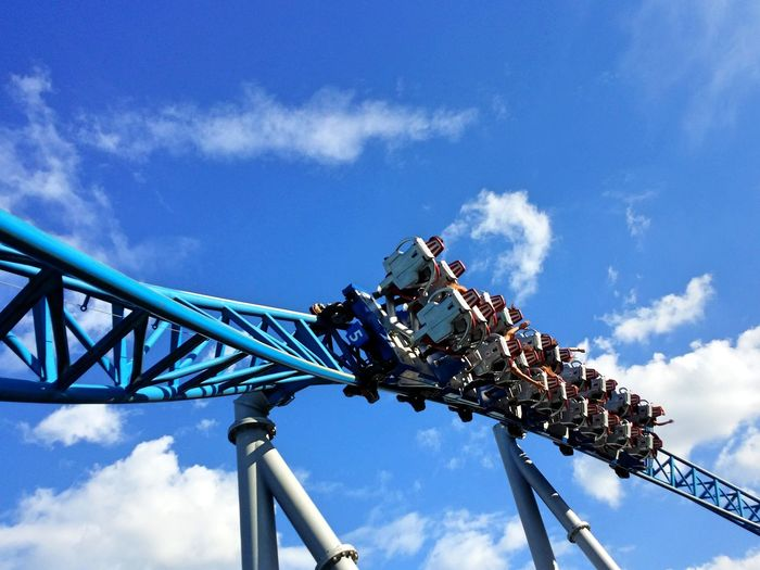 Low Angle View Of Rollercoaster Ride Against Sky
