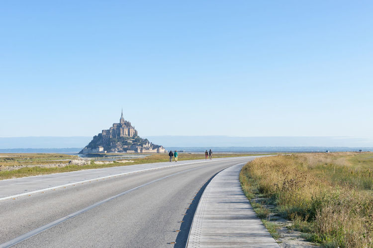 Architecture Building Exterior Built Structure Clear Sky Day France Grass Horizon Over Water Mont Saint Michel Montsaintmichel Mount Saint Michel Mountsaintmichel Nature No People Normandie Normandy Outdoors Road Scenics Sea Sky The Way Forward Travel Destinations Water