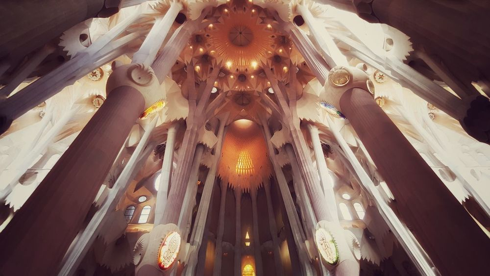 Religious Architecture EyeEmNewHere Architecture And Nature Columns Warm Light Gaudí Architecture Barcelona Sagrada Familia Cathedral Low Angle View Ceiling Indoors  Architecture Place Of Worship Built Structure No People Architectural Design Travel Destinations Illuminated Spirituality Religion