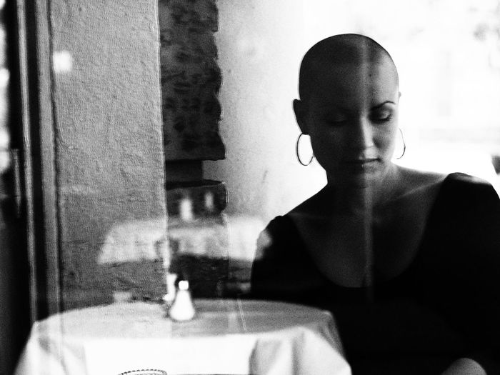 Alone Bald Bald Girl Black & White Black And White Blackandwhite Cafe Cafeteria Real People Sad Sadness Shaved Hair Shaved Head Solitude Vintage Vintage Photo Vintage Style Woman