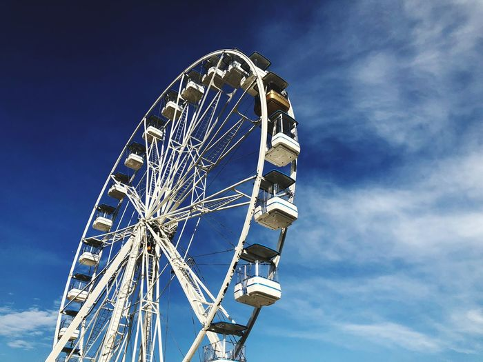 EyeEm Selects Amusement Park Amusement Park Ride Ferris Wheel Sky Arts Culture And Entertainment Low Angle View Circle Fun Fairground Geometric Shape Architecture Leisure Activity Shape No People Large Carnival Day Blue Nature Outdoors