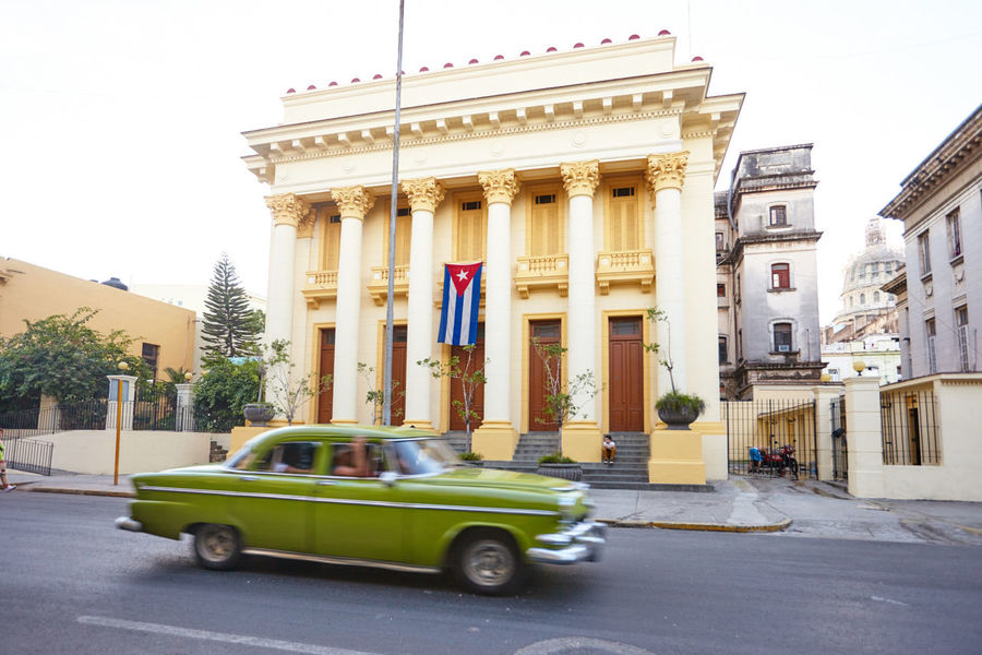Architectural Column Architecture Building Exterior Built Structure Car City Clear Sky Cuba Collection Cuban Cars Cuban Flag Day Havana Land Vehicle Mode Of Transport No People Outdoors Sky Transportation Tree Vintage Car