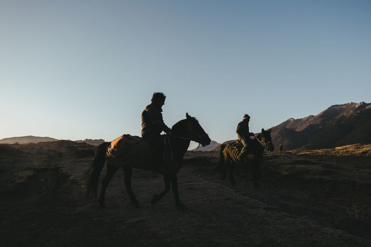 People riding horse