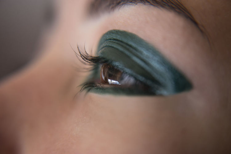 Close-up of cropped woman with eye make-up
