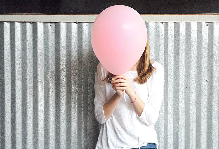 Woman standing on a balloon