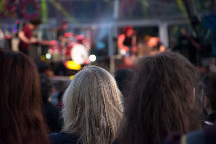 Human Body Part Standing Lifestyles Outdoors People Real People Focus On Foreground Concert