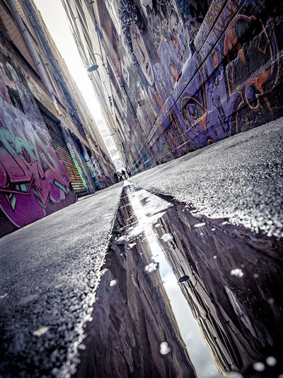 City City Life Graffiti Low Angle View Quiet Street Reflection Architecture Built Structure Close-up Day Laneway Melbourne No People Outdoors Textured  Transportation Urban Urbanphotography