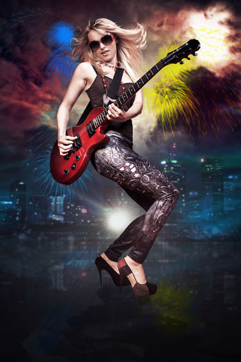 Digital Composite Image Of Woman Playing Guitar