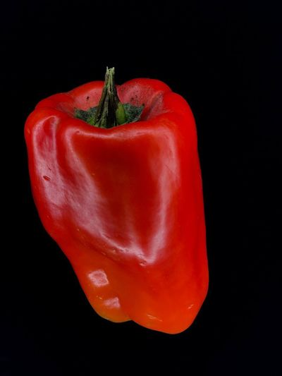 Close-up of red bell pepper against black background