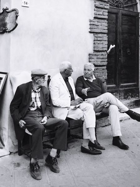 Three old man on a bench Senior Adult Senior Men Sitting Full Length Real People Men Senior Women Mature Men Built Structure Mature Adult Architecture Building Exterior Day Outdoors Women Togetherness Adult People Italian Take It Easy Relax Wise Man