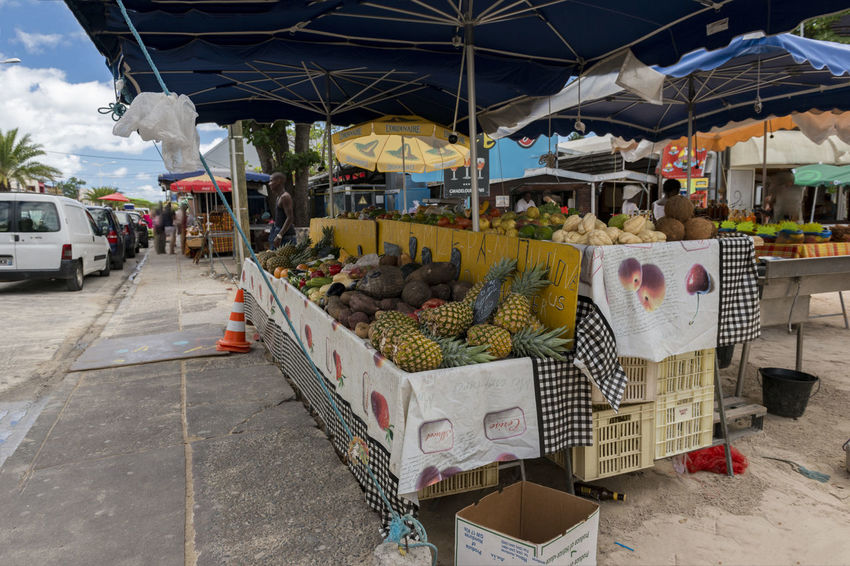 small market booth on Guadeloupe Antilles Françaises Antilles State Caribbean Island Fruits And Vegetables Guadeloupe Islands Over The Wind Market Sky And Clouds Antilles Blue Sky Booth Caribbean Fruits Sky Small Antilles Street Vegetables White