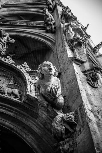 Architecture Art And Craft Low Angle View Built Structure Sculpture Representation Building Exterior Statue Craft Gargoyle Day No People Building Creativity Religion The Past History Animal Representation Carving - Craft Product