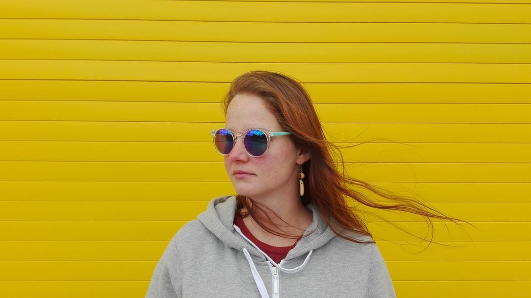 Sunglasses Yellow Background Sunglasses Yellow Summer Colored Background Headshot Portrait One Person People Day Adult Outdoors Only Women Smiling Adults Only One Woman Only Human Body Part Protruding Young Adult Close-up outfit