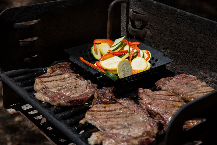 Meat And Vegetables On Barbeque Grill In Park