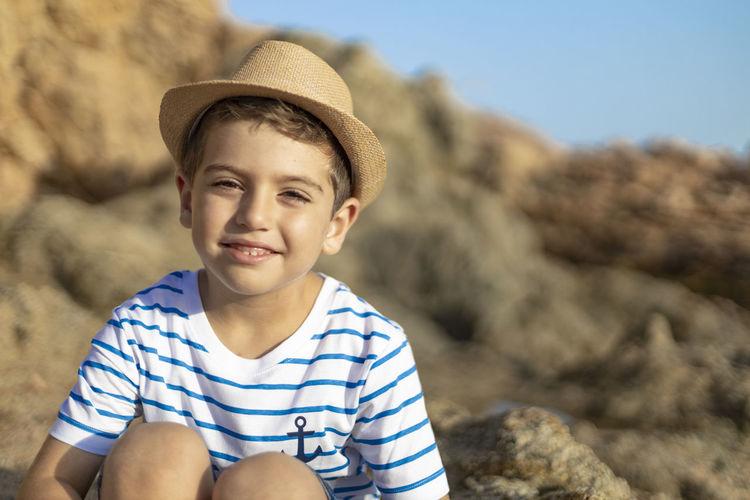 Portrait of smiling boy in rock