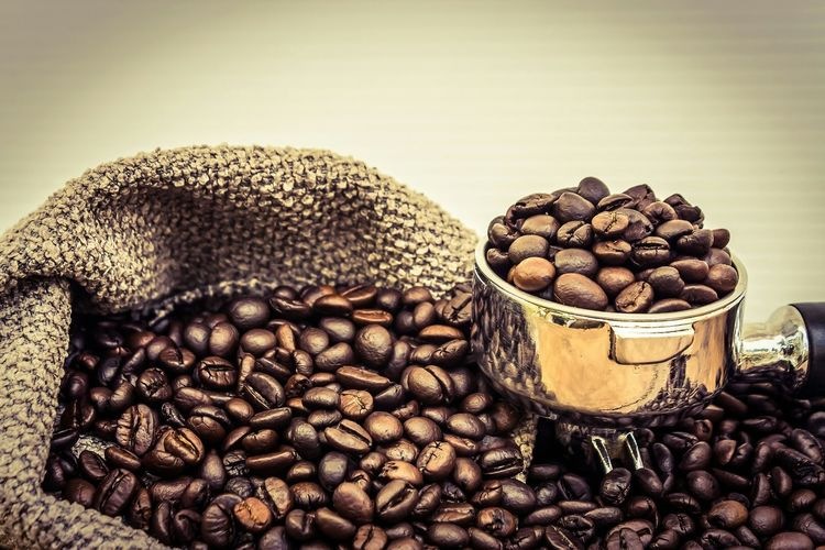 Coffee beans in sack against wall