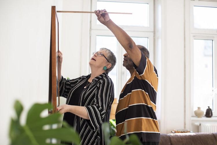 Woman looking at camera at home