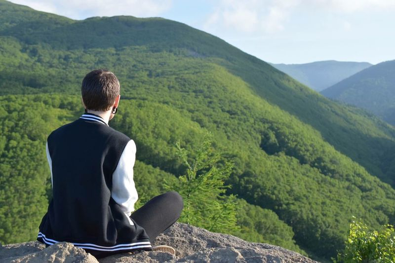 Mountain Rear View Sitting Looking At View One Person Tree Adult Relaxation Nature Landscape Men One Man Only Mountain Range Outdoors Only Men Day Beauty In Nature Full Length Scenics People