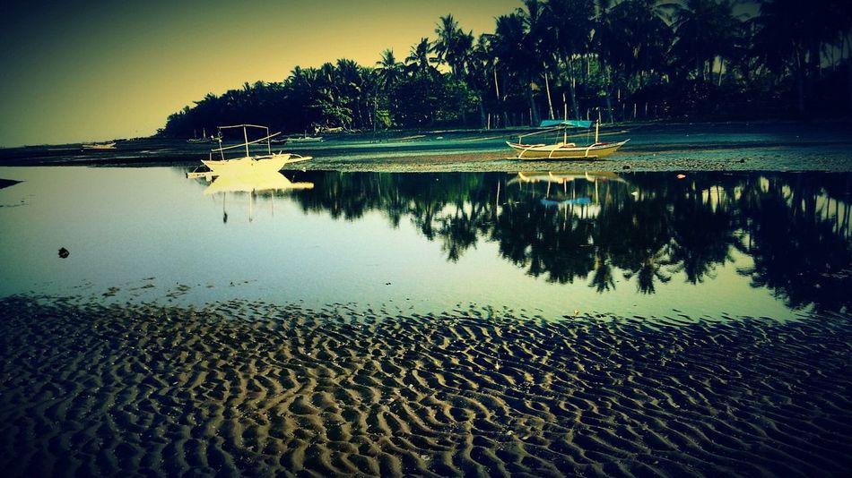Taking Photos Boats Water Reflections On The Beach Life Is A Beach Naturelovers Nature Sunset #sun #clouds #skylovers #sky #nature #beautifulinnature #naturalbeauty #photography #landscape Beautiful Nature Beautiful Day