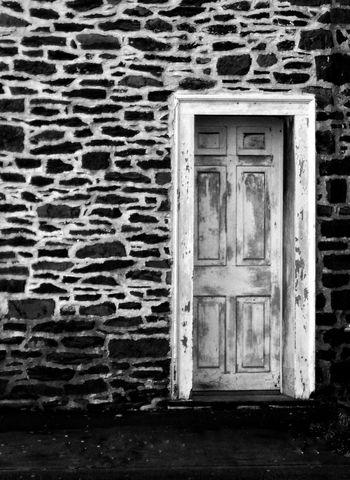 Door number 1 ... Bnw_doors Bnw_friday_eyeemchallenge Built Structure Door Architecture Building Exterior No People House Brick Wall Outdoors Day Stone Wall Fortheloveofblackandwhite Bw_collection Blackandwhite