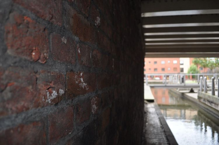 Under the bridge. Built Structure Architecture Brick Wall Day No People Close-up Outdoors Canal Under The Bridge Wall Canals And Waterways Water Architecture Buildings City Life Getty X EyeEm City Brick Wall Mind The Gap Urban Exploration EyeEm Masterclass Urban Love EyeEm Fresh On Eyeem  EyeEm Gallery