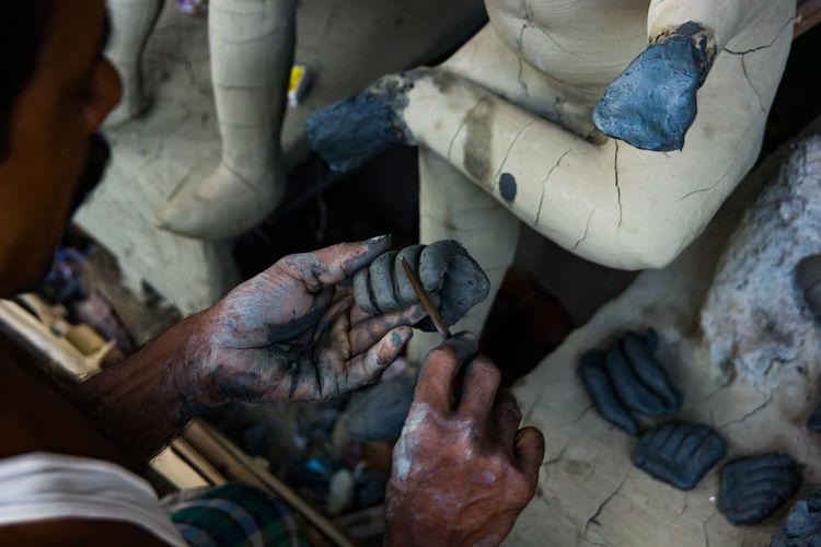 Man making statue in workshop