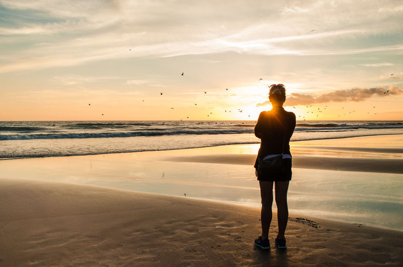 A summer sunset on the beach. Jack Nobre July Portugal Romance Travel Beach Beauty In Nature Golden Hour Horizon Over Water Leisure Activity Lifestyles Nature Outdoors Real People Sand Scenics Sea Shore Sky Standing Summer Sunset Warm Water