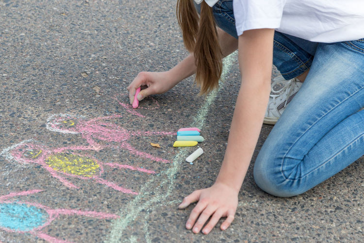 children draw in crayon on asphalt Happiness Friendship Doodle Sketching Game Chalking Pavement Colorful Activity Creative Playground Happy Lifestyle Playing Coloring Painting Leisure Activity Leisure Education Artist House Cute Play People Image Draw Art Outside Street Sidewalk Closeup Close Up Hand Color Fun Outdoor Day Summer Crayons Children Family Chalk Drawing Asphalt Creativity Child Childhood Copy Space Copyspace Girl