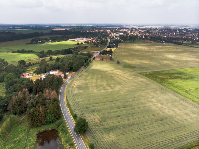 Aerial view of a village suburb in the rural area of Saxony-Anhalt Aerial Aerial View Architecture Building Exterior Cloud - Sky Countryside Day Drop Environment Field Grass Green Color High Angle View Land Landscape Nature No People Outdoors Patchwork Landscape Plant Scenics - Nature Sky Tree