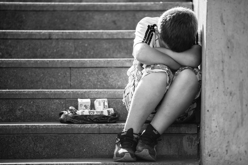 a young boy was too tired to sell wipes and cigarettes in Istanbul Alone Day Lifestyles Orphanage Outdoors Person Poor  Selling Tired