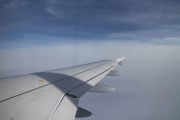 Air Vehicle Aircraft Wing Airplane Airplane Wing Beauty In Nature Close-up Cloud - Sky Day Flying Journey Mode Of Transport Nature No People Outdoors Sky Transportation
