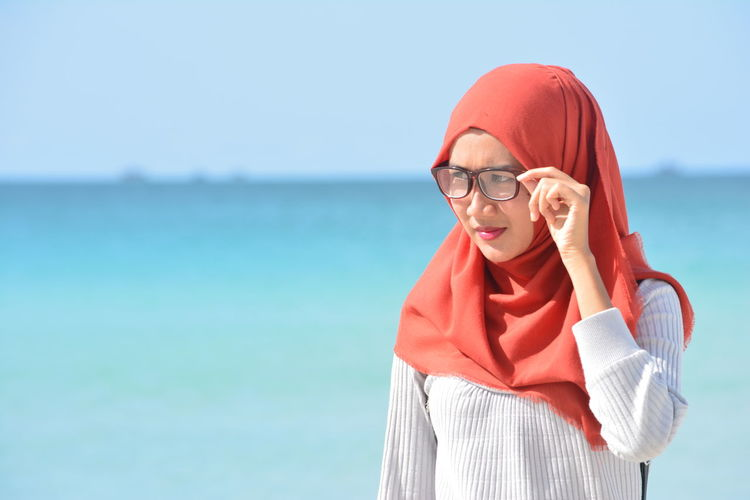 Woman Wearing Hijab While Standing Against Sea