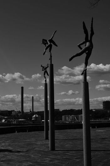 All In A Row Angels Carl Milles Chimneys Clouds And Sky Cloudy Day From Behind Hovering Above In Line Playing Podium Sculpture Sculpture Garden Stockholm Stone Sweden Blackandwhite Photography Black And White Photography