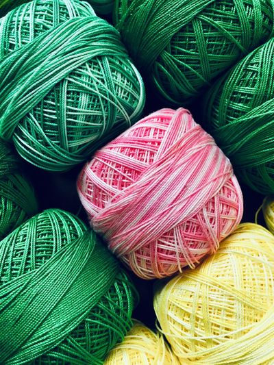 Rolls of sewing thread Haberdashery Cotton Thread Wool Sewing Multi Colored Still Life Art And Craft Wool Material Thread Textile Abundance Choice Ball Of Wool Craft Green Color Variation