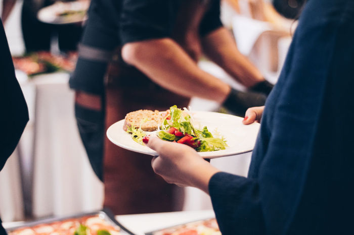 Food Getting Food Adult Business Dinner Focus On Foreground Food Food And Drink Food From Buffet Food On Plate Freshness Group Of People Holding Human Body Part Human Hand Indoors  Lifestyles Men Midsection Plate Plates Ready-to-eat Real People Restaurant Tray Women