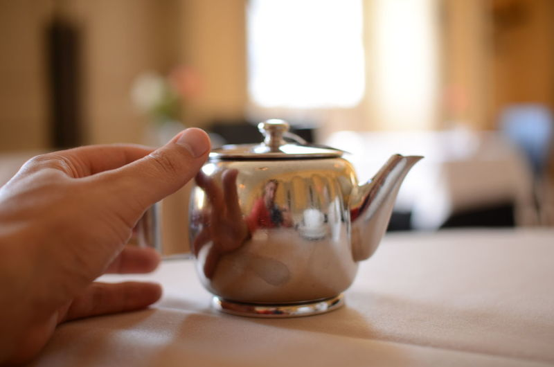 Afternoon Tea Close-up Drink Food And Drink Freshness High Tea Human Body Part Human Hand Indoors  One Person Reflection Reflection_collection Reflections Tea Tea - Hot Drink Tea Cup Tea Or Coffee Tea Time Teapot