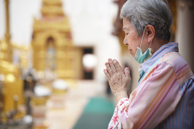Side view of a woman at temple