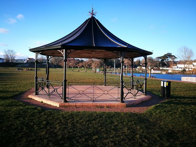 lonely band stand Architecture Band Stand Beauty In Nature Built Structure Clear Sky Day Gazebo Grass Landscape Nature No People Outdoors Sky Tree