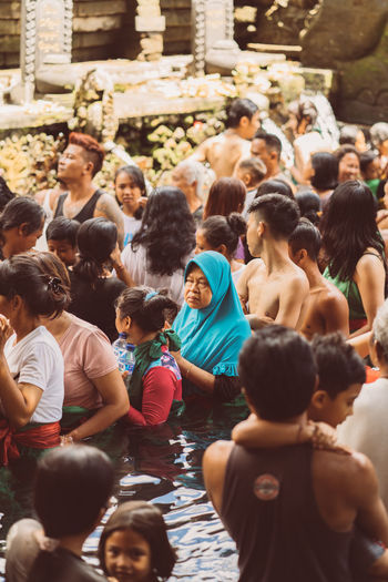 Bali INDONESIA Bali Temple Temple Water Temple Religious Festival Hindu Hinduism Real People Lifestyles Men Crowd Group Of People Large Group Of People Women Adult Togetherness Sitting Day Leisure Activity Architecture Males  Boys Selective Focus Childhood Mixed Age Range Enjoyment